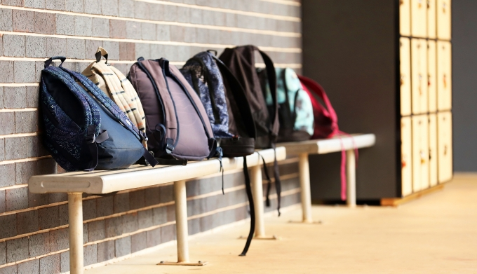 School backpacks on the bench